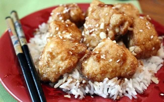 Honey Garlic Chicken. Sweet and tangy Asian fried chicken with a garlic, honey, soy, sesame sauce. This goes great with noodles or rice. Small Town Girl Blog