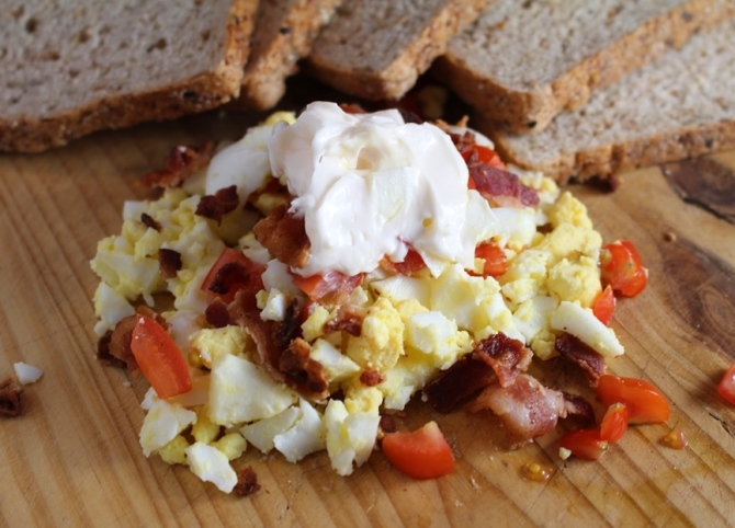 Revamp your traditional egg salad by adding tomatoes and bacon! Yum! Hello! You know you want this.