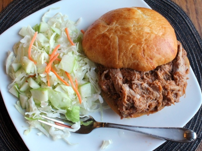 Fall off the bone pulled pork smothered in barbecue sauce! Served on a bun or straight up with a side of coleslaw, this savory dish will have the whole family in very messy grins. Small Town Girl Blog
