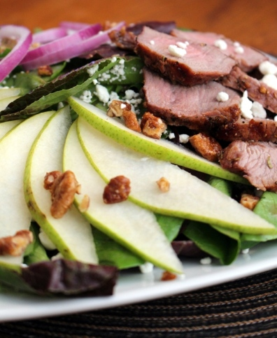 Steak Salad with Chevre and Pears. Savory steak blends well with sharp cheeses, tart fruits, and leafy greens. In this case, pears and goat cheese or chevare. Tossed with my favorite balsamic vinaigrette, this meal is sure to please. Small Town Girl Blog