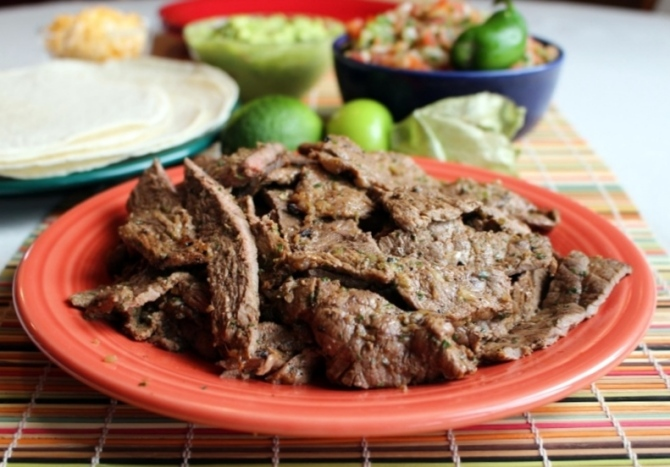 Carne Asada. Paper-thin slices of steak marinated and grilled to perfection with citrus and traditional Mexican flavors. Small Town Girl Blog.